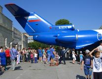 A large crowd of people women men children on holiday look at the tail of the aircraft walk. A large crowd of people women men children on holiday in the summer royalty free stock photo