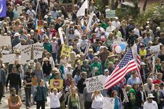 A large crowd of protesters march and chant down State Street carrying signs at an anti-Iraq War protest march in Santa Barbara, C. Alifornia on March 17, 2007 Royalty Free Stock Photo