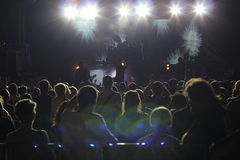 Large crowd at a rock concert. Large crowd of people at a concert, with lights effect Stock Photos