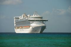 Large cruise ship. Passenger vessel anchored in the deep blue caribbean Stock Photo