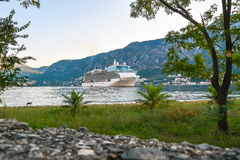 Large cruise ship at anchor in the Bay of Kotor Royalty Free Stock Photos
