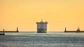 Large cruise ship approaching the harbor Stock Image