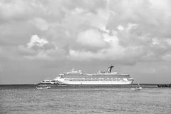 Large cruise ship in bay on water, Cozumel, Mexico. Cozumel, Mexico - December 24, 2015: large cruise ship or liner in bay or harbor, touristic passenger boat on Stock Image