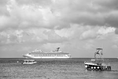 Large cruise ship in bay on water, Cozumel, Mexico. Cozumel, Mexico - December 24, 2015: large cruise ship or liner in bay or harbor, touristic passenger boat on Royalty Free Stock Photo