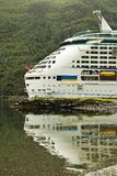 Large cruise ship in Flom port, Norway, reflection in water. Summer view of Sognefjorden fjord, Norway. Large cruise ship in Flom port, Norway, reflection in Stock Photography