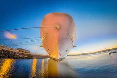 Large cruise ship moored at pier at sunset. Large cruise ship moored at pier at  sunset Royalty Free Stock Image