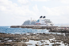 Large Cruise Ship at the Port of Rethymno on the island of Crete. RETHIMNO, GREECE - OCTOBER 3, 2014: Large Cruise Ship at the Port of Rethymno on the island of Stock Image