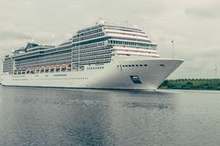 Large cruise ship sailing through the North sea canal Netherlands stock photography