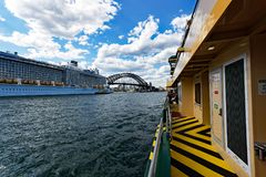Large Cruise Ship, Sydney Harbour, Australia. A large modern cruise ship with a duck egg blue hull and white superstructure moored at the International Royalty Free Stock Photos
