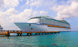 Large cruise ship Voyager of the Seas is docked. Over 3,500 guests went out to visit beautiful tropical island. Stock Images