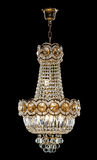 Large crystal chandelier in baroque style isolated on black background. Royalty Free Stock Image