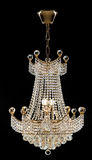 Large crystal chandelier in baroque style isolated on black background. Royalty Free Stock Photo