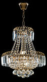Large crystal chandelier in baroque style isolated on black background. Royalty Free Stock Photography