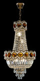 Large crystal chandelier in baroque style isolated on black background. Stock Image