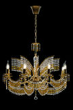 Large crystal chandelier with candles isolated on black background. Luxury royal expensive chandelier for living room, Hall of celebration stock image