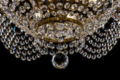 Large crystal chandelier close-up in baroque style  on black background. Royalty Free Stock Images