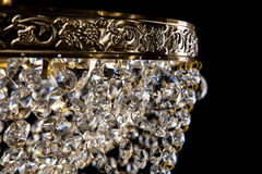 Large crystal chandelier close-up in baroque style  on black background. Stock Image