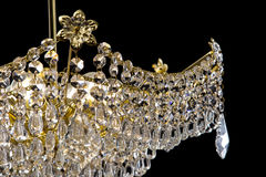 Large crystal chandelier close-up in baroque style  on black background. Stock Images