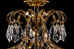 Large crystal chandelier close-up in baroque style  on black background. Stock Photos