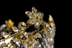 Large crystal chandelier close-up in baroque style  on black background. Royalty Free Stock Image