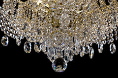 Large crystal chandelier close-up in baroque style  on black background. Royalty Free Stock Photography