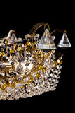 Large crystal chandelier close-up in baroque style  on black background. Stock Photo