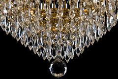 Large crystal chandelier close-up in baroque style  on black background. Royalty Free Stock Photos