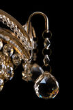 Large crystal chandelier close-up in baroque style  on black background. Stock Photography