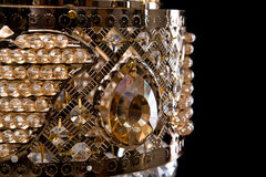 Large crystal chandelier close-up in baroque style isolated on black background. Royalty Free Stock Photo