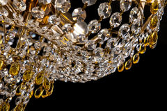 Large crystal chandelier close-up in baroque style isolated on black background. Royalty Free Stock Photos