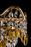 Large crystal chandelier close-up in baroque style isolated on black background. Royalty Free Stock Image
