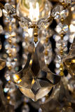 Large crystal chandelier close-up in baroque style isolated on black background. Royalty Free Stock Images