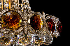 Large crystal chandelier close-up in baroque style isolated on black background. Stock Images