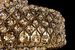 Large crystal chandelier close-up in baroque style isolated on black background. Stock Photos