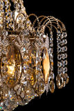 Large crystal chandelier close-up in baroque style isolated on black background. Stock Photo