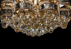 Large crystal chandelier close-up in baroque style isolated on black background. Royalty Free Stock Photography
