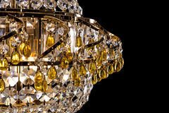 Large crystal chandelier detail isolated on black background. Luxury expensive chandelier for living room, Hall of celebration. Beautiful crystal decoration Royalty Free Stock Photo