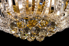 Large crystal chandelier details isolated on black background. Royalty Free Stock Photos