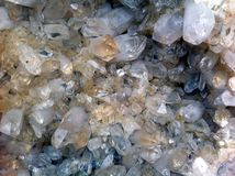 Large crystals of natural or artificial quartz. Close-up photo.  Royalty Free Stock Photography
