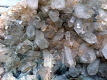 Large crystals of natural or artificial quartz. Close-up photo.  Royalty Free Stock Image
