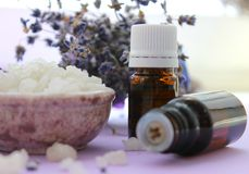 Large crystals of sea salt and jars of essential oils.Aromatherapy and Spa treatments, bathing, relaxation stock images
