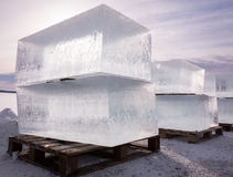 Large cubes of clear ice with beautiful backlight in Finland Stock Photography
