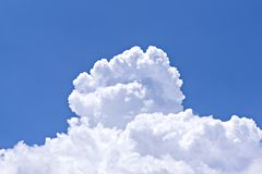Large cumulus cloud on clear blue sky. Concept of environmental pollution royalty free stock image