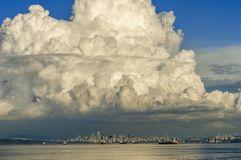 Large cumulus cloud over downtown Vancouver, British Columbia, Canada. stock photo