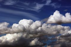Cumulus clouds in the blue sky royalty free stock photo