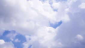 Large Cumulus Clouds Moving On A Blue Sky stock footage