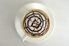 Large cup of coffee decorated with milk Royalty Free Stock Photography