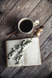 Large Cup of coffee on vintage wooden background. Spring flowers and books. Stock Images