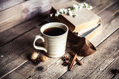 Large Cup of coffee on vintage wooden background. Spring flowers and books. Royalty Free Stock Photos