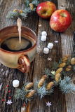 Large cup of hot coffee, red apples and pine branches Stock Images